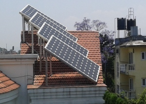 Our neighbors solar panels and 2 water tanks of an apartment building in the next lane.
