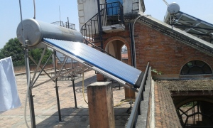 Solar panels and tank on the terrace of our apartment building