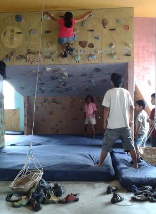 Janani climbing at the mini-gym.