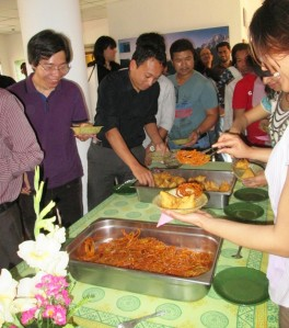 ICIMOD colleagues descending on the refreshments at an all-hands meeting.