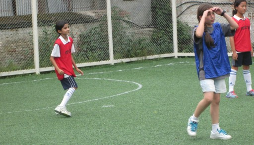 Janani playing defense at the soccer match.  TBS lost 3-2 against KISC.