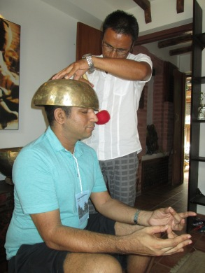 Dinesh receiving therapy from a healing bowl specialist.