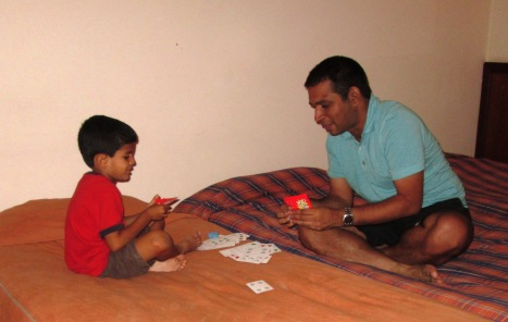 Sumi beating Dinesh in a game of Blink!