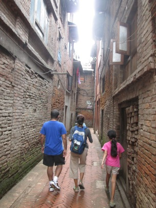 Walking down a narrow alley in Bhaktapur.