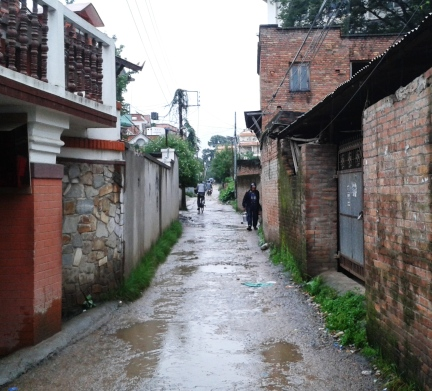 An average KTM lane after the rain, submerged in muddy puddles
