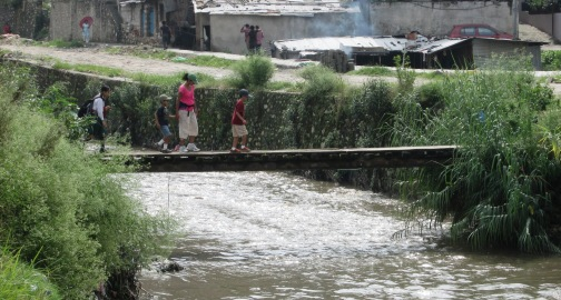 We crossed the river along an old, narrow, wooden pedestrian bridge.  Low and behold, after we walked over, a motorcycle daringly went across the 2-foot-wide, rickety passage!
