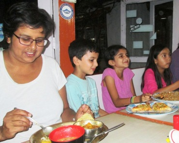 Arthi having daal bhaat, Sajjan having pizza, Janani having fried rice and Maya having chicken curry!  Miles and miles away from town -- it was unbelievable!