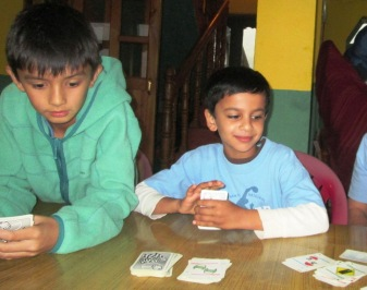 Dan and Sajjan playing the Mille Bourne card game