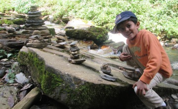 Sumanth next to the cairn he built