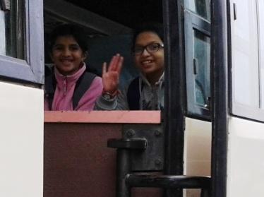 Meghna and I waved goodbye to our parents from the bus.
