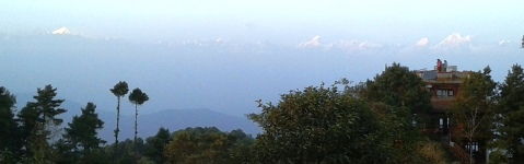 """A crisp, breezy evening atop Nagarkot hill.  The long vista of snow-capped peaks """"peaking"""" through the clouds was beautiful."""