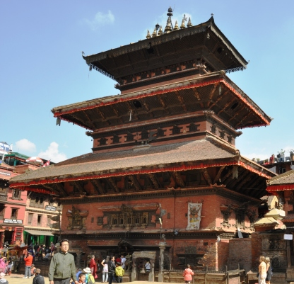 How do they replace the shiny red cloth decoration at the edge of the pagoda tiers?  Kathmandu is looking its finest in preparation for the SAARC Summit.