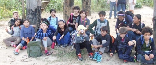 Resting in the shade during a long hike.  Everyone's wearing long sleeves and long pants because of the mosquitoes.