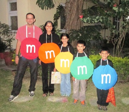 Home-made MnM costumes - colorful T-shirts, cardboard circles, cotton stuffing and a bit of white fabric - that's all it took!