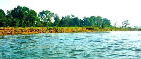 The rivers in Chitwan are pretty and blue unlike the rivers in Kathmandu.