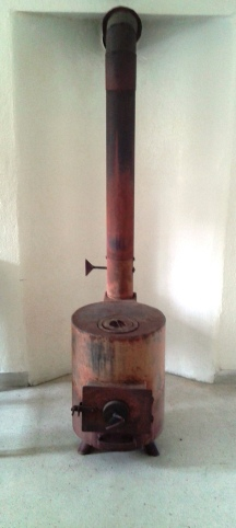 Sitting next to it now as I type this blog post!  The most effective indoor heating device, our wood stove.