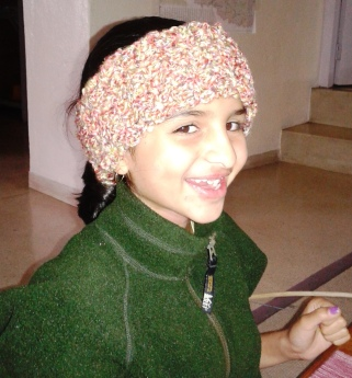 """Janani wearing a """"head warmer"""" I crocheted for her.  She also learned and made a few more!"""