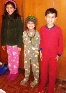 Kids getting ready for bed - footsie pajamas, woolen hats, fleece jumpers, and warm Nepali felt house slippers.