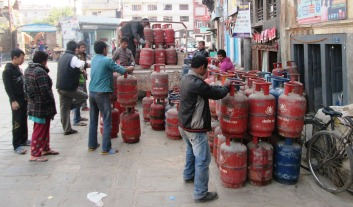 Truck getting loaded with gas cylinders - people hold their's in queues for days, sometimes weeks!