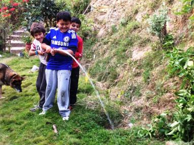 Nishchal, Yulo and me watering the tree we planted!