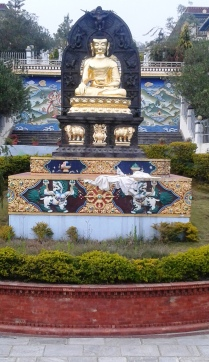Golden Buddha statue in the garden of the monastery.